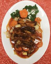 Image de Côtes panées en sauce aigre-doux